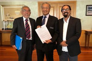 Fugitive and former Singapore student union leader Tan Wah Piow with Malaysian Prime Minister Mahathir Mohamad and Malaysian political and social activist Hishamuddin Rais in Putrajaya on Aug 30, 2018.