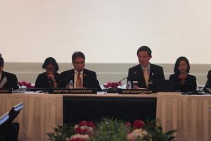 Trade and Industry Minister Chan Chun Sing (right), who is AEM chairman, delivering his opening remarks at the 6th RCEP Ministerial Meeting at Shangri-la Hotel on Aug 30, 2018.