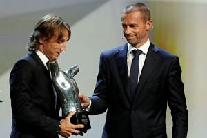 Uefa president Aleksander Ceferin presents Modric with the Player of the Year award.