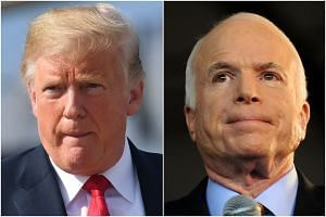 US President Donald Trump (left) and Senator John McCain clashed on a range of policy issues.