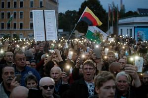 """The far-right group """"Pro Chemnitz"""" stage a protest at the entrance to the stadium of Chemnitz FC, on Aug 30, 2018, amid tensions sparked by a deadly stabbing in Chemnitz, eastern Germany."""