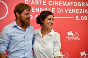 """Director Alessio Romenzi and director Francesca Mannochi attend a photocall for the film """"Isis, Tomorrow. The Lost Souls of Mosul"""" on Aug 30, 2018, presented out of competition during the 75th Venice Film Festival at Venice Lido."""