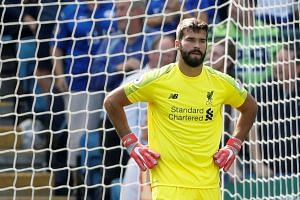 Liverpool's Alisson looks dejected after Leicester City's first goal.