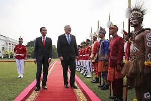 Indonesian President Joko Widodo with visiting Australian Prime Minister Scott Morrison at a welcome ceremony at the Bogor presidential palace in West Java yesterday.
