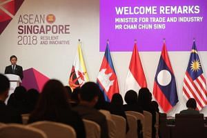 Trade and Industry Minister Chan Chun Sing (centre) speaks at the opening ceremony of the 50th Asean Economic Ministers Meeting in Singapore on Aug 29, 2018.