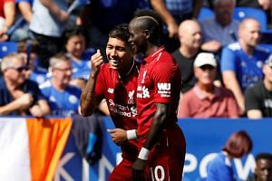 Liverpool's Roberto Firmino celebrates scoring their second goal with teammate Sadio Mane during their English Premier League match against Leicester City at the King Power Stadium on Sept 1, 2018.