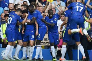 Chelsea's Pedro celebrates with team mates after scoring.