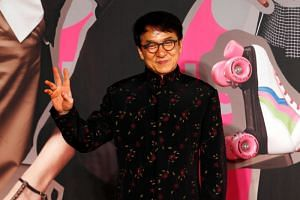 Actor Jackie Chan poses on the red carpet at the 37th Hong Kong Film Awards on April 15, 2018.