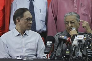 Datuk Seri Anwar Ibrahim (left) with Malaysian Prime Minister Mahathir Mohamad during a press conference in Kuala Lumpur, on June 1, 2018.