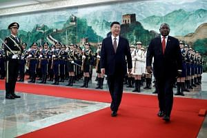 South Africa's President Cyril Ramaphosa and China's President Xi Jinping reviewing the honour guard at the Great Hall of the People in Beijing, China, on Sept 2, 2018.