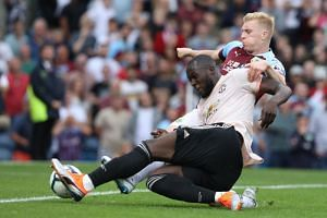 Manchester United's Belgian striker Romelu Lukaku (left) vies with Burnley's English defender Ben Mee during the EPL match between Burnley and Manchester United at Turf Moor in Burnley, north west England on Sept 2, 2018.