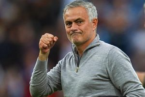 Manchester United manager Jose Mourinho celebrates after the EPL match between Burnley FC and Manchester United in Burnley, Britain, on Sept 2, 2018.