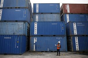 A file photo taken on Dec 15, 2015, shows a worker tracking shipping containers at Tanjung Priok port in North Jakarta. The Indonesian government is stepping up efforts to curb imports and halt a sliding currency.