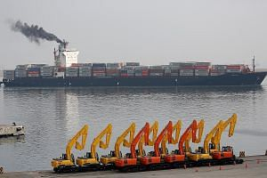 A container ship near the Tanjung Priok Car Terminal in Jakarta. The Indonesian authorities have reviewed 900 products - from luxury items to basic goods like coffee, tea, pasta and ice cream - some of which will soon carry higher import taxes.