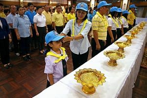 People attending a ceremony to join the Volunteer Spirit scheme in Bangkok last month. Over four million volunteers from all walks of life have joined the programme, said officials.