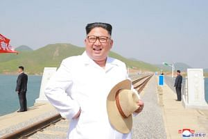 North Korean leader Kim Jong Un inspects the completed railway that connects Koam and Dapchon, in this undated photo released by North Korea's Korean Central News Agency in Pyongyang, on May 24, 2018.