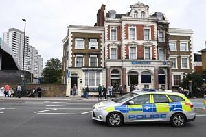 A police car drives past the City Stay hotel in Bow, east London, Britain, on Sept 5, 2018, where traces of Novichok nerve agent where found in a room.