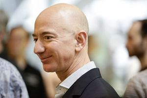 Bezos (above) has regained his crown as the richest person on the planet.