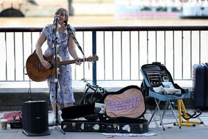 Busker Charlotte Campbell, who sings for her supper almost every day in the shadow of the London Eye top tourist attraction, was one of the first performers to use a contactless card reader.