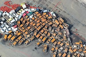Burnt vehicles left behind after a storm surge and strong winds in Nishinomiya, Hyogo prefecture, on Sept 5, 2018.