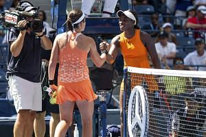 Sevastova and Stephens meet at the net after their quarter-finals match.