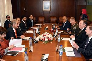 Pakistani Foreign Minister Shah Mehmood Qureshi (second from left) and United States Secretary of State Mike Pompeo (second from right) meeting in Islamabad yesterday. The US has cut military aid to Pakistan over Islamabad's alleged reluctance to cra
