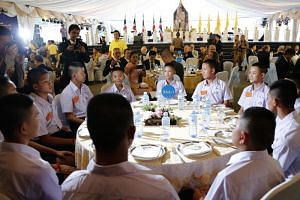 Members of the young Thai football team who were rescued from Tham Luang attend a thank-you dinner presided by Prime Minister Prayut Chan-o-cha in Bangkok on Sept 6, 2018.