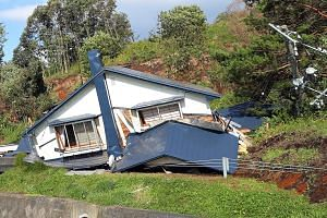 A collapsed house is seen following a large landslide that occured after an earthquake hit Hokkaido, in Atsuma, northern Japan, Sept 6, 2018.