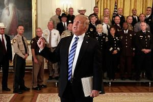 US President Donald Trump speaking to the media at a meeting with sheriffs from across the country at the White House on Wednesday. The writer says there is no crisis if and when officials countermand presidential policy. The crisis would arise only