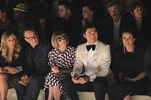 With Crazy Rich Asians landing a box-office punch in North America, star Henry Golding (second from right) is now in heavyweight territory. At the Tom Ford show on Wednesday that started New York Fashion Week, he was a media knockout along with (from