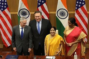 US Defence Secretary James Mattis (left) and Secretary of State Mike Pompeo posing for a photo with India's Defence Minister Nirmala Sitharaman (right) and External Affairs Minister Sushma Swaraj after their