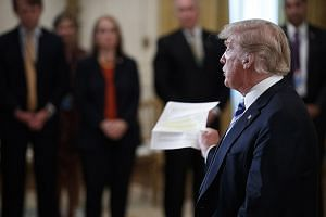 US President Donald Trump responding to a question from the news media after delivering remarks during a meeting with sheriffs from across the country at the White House on Wednesday. The New York Times column drew immediate and extraordinary attenti