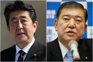 Japanese Prime Minister Shinzo Abe (left) and one-time defence minister Shigeru Ishiba were formally nominated to compete in an internal Liberal Democratic Party election.