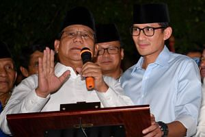 """""""We are gravely concerned with the endless weakening of the rupiah,"""" said retired army general Prabowo Subianto (left) and his running mate for the 2019 presidential polls, Mr Sandiaga Uno."""