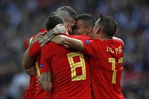 Spain's striker Rodrigo celebrates with teammates after scoring their second goal.