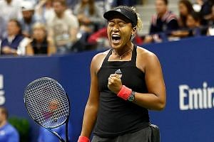 A pumped-up Naomi Osaka during the final, in which she shut out the distractions for a straight-sets win.
