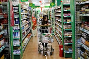 A consumer is seen at an international supermarket in Beijing, China, on June 29, 2018.