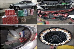 The cigarettes were hidden in various modified compartments of a Singapore-registered car.