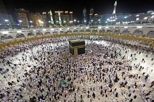Muslim worshippers gather at the Grand Mosque in Islam's holiest city of Mecca, on June 14, 2018.