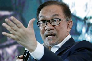 Malaysia's former deputy prime minister Anwar Ibrahim delivering a speech in Manila, on Sept 4, 2018.