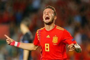 Spain's Saul Niguez celebrates scoring their first goal at the Nations League match.