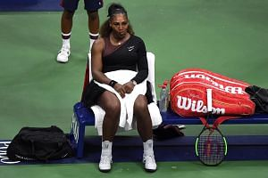 Serena Williams sits at her bench after yelling at the chair umpire during the women's final against Naomi Osaka (not pictured).