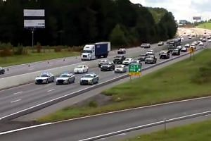 South Carolina Highway Patrol cars escorting a line of vehicles as residents prepare ahead of Hurricane Florence's descent, on Sept 11, 2018. To speed evacuations, officials in South Carolina reversed the flow of traffic on some highways so that all