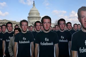 Cardboard cut-outs of Facebook chief Mark Zuckerberg are part of a protest outside the US Capitol in April 2018.