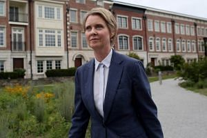 New York Democratic gubernatorial candidate Cynthia Nixon sparked debate after ordering a cinnamon raisin bagel with lox, capers, red onions, tomato, and cream cheese.