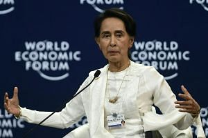 Myanmar State Counsellor Aung San Suu Kyi speaks at the World Economic Forum on ASEAN at the National Convention Center in Hanoi, on Sept 13, 2018.