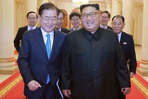 North Korean leader Kim Jong Un (right) with South Korean president's special envoy Chung Eui-yong in Pyongyang, on Sept 6, 2018.