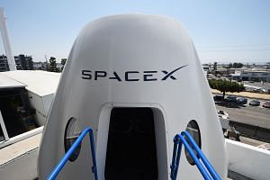 File photo of a mock up of the Crew Dragon spacecraft is displayed during a media tour of SpaceX headquarters and rocket factory in Hawthorne, California, on Aug 13, 2018.