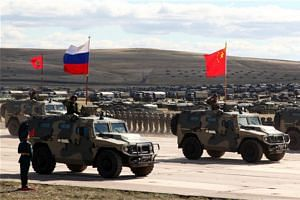 China, Russia and Mongolia concluded the Vostok-2018 strategic drills with a military parade at the Tsugol training range in Russia's Trans-Baikal region on Sept 13.