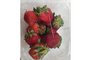 The police have said that six brands of strawberries in Australia are believed to be contaminated with needles and pins, prompting warnings from authorities to slice the fruit before eating.